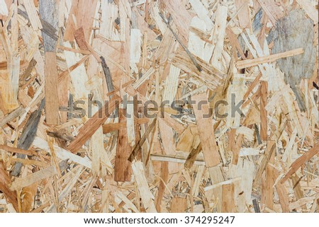 Close up texture of oriented strand board - OSB, Wood board made from piece of wood - stock photo