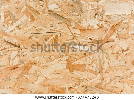 Close up texture of oriented strand board (OSB), Wood board made from piece of wood - stock photo