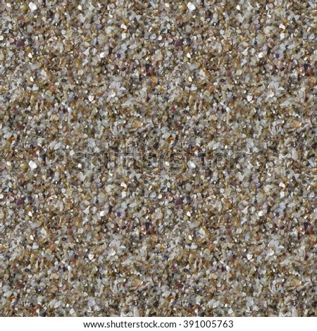 Close-up texture shot of colorful wet beach sand, ideal for use as a background or texture. Seamless pattern tile. - stock photo