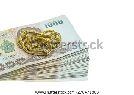 Close up Thai money in one thousand type banknotes with gold necklace isolated on white background - stock photo