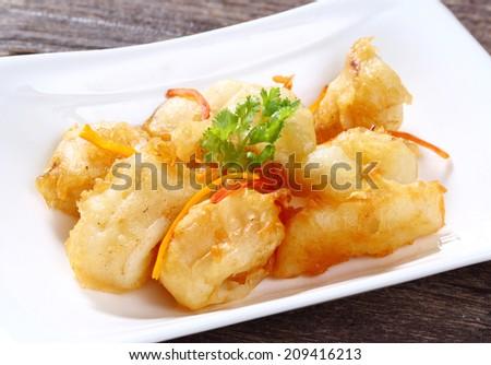 Close up Thai style squid tempura served on white dish - stock photo