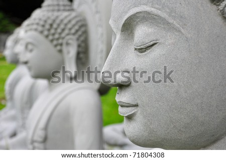 Close up the Buddha face - stock photo