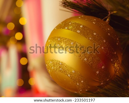 Close-up  the decorative single golden christmas ball with  defocused bokeh lights. : filtered process - stock photo