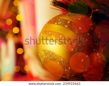 Close-up  the decorative single golden christmas ball with  defocused bokeh lights.: filtered process - stock photo