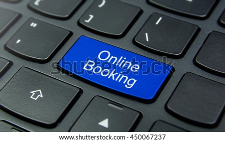 Close-up the Online Booking button on the keyboard and have Blue color button isolate black keyboard - stock photo