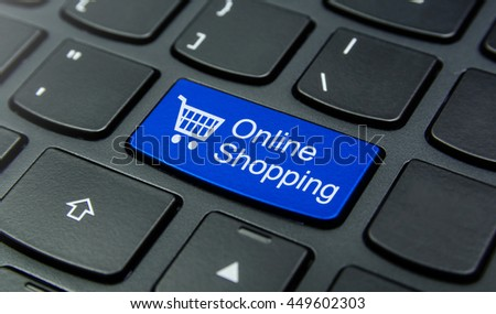 Close-up the Online Shopping with Shopping Cart symbol button on the keyboard and have Blue color button isolate black keyboard - stock photo