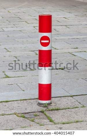 Close up the red traffic pole and no entry sign with brick walk background. - stock photo