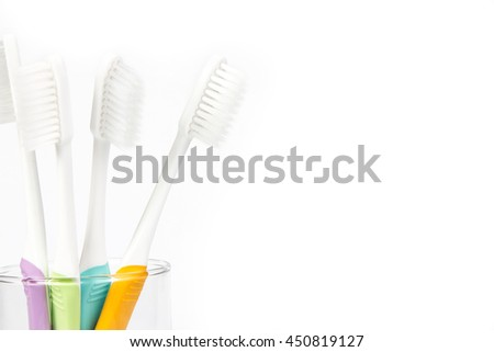 close up the  toothbrush in transparent glass on white background - stock photo