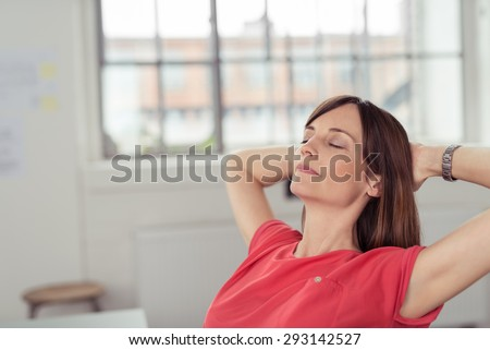 Close up Thoughtful Office Woman Leaning her Back on a Chair to Relax with Both hands on the Back of her Head and Eyes Closed. - stock photo