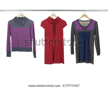 Close up three female clothes with sundress on a hanger - stock photo