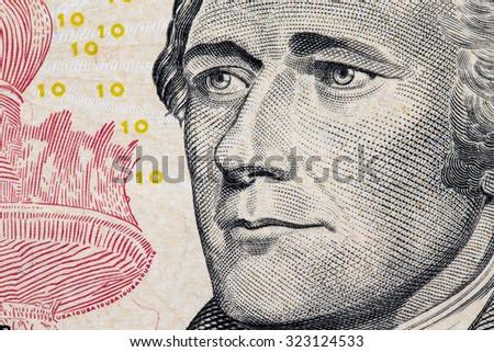Close up to Alexander Hamilton portrait on ten dollar bill. - stock photo
