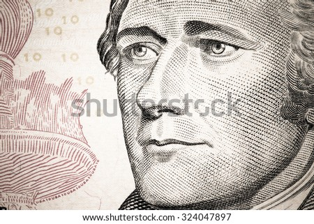 Close up to Alexander Hamilton portrait on ten dollar bill. Toned. - stock photo