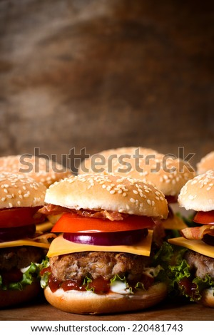 Close up to beef burger with cheese and vegetables.Blank space above - stock photo