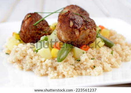 Close up to meat balls and couscous in the plate,selective focus  - stock photo