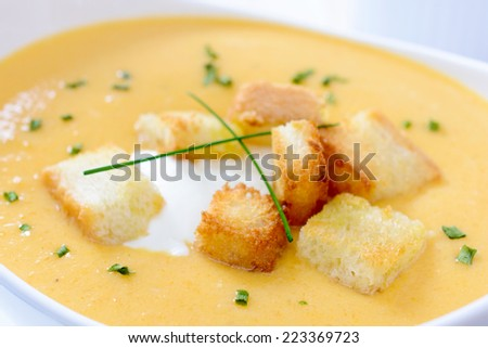 Close up to pumpkin soup with croutons bread,selective focus  - stock photo
