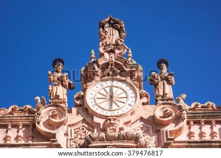 Close up to Santa Prisca clock cathedral in taxco guerrero. - stock photo