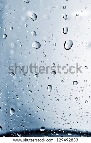 Close up to water drops on glass - stock photo