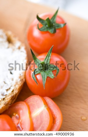 close up tomatoes cherry and piece of bread - stock photo
