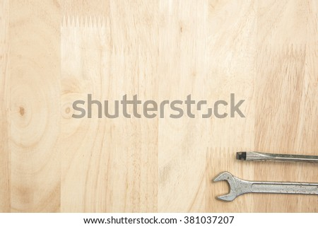 Close up tools on a wooden background - stock photo
