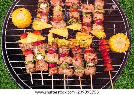 Close up top view bbq and corncob on a grilling pan  - stock photo