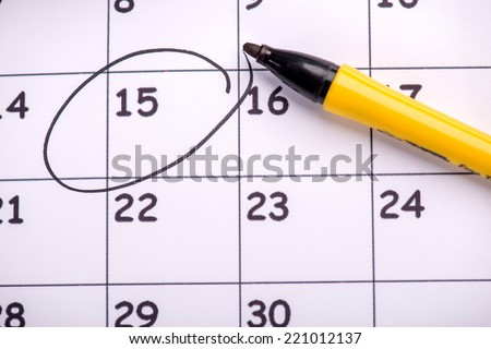 Close-up top-view photo of calendar with a datum circled with a back marker, concept of time management at work - stock photo
