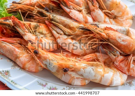close up top view steamed shrimp/prawn in the white plate ready to eat - stock photo