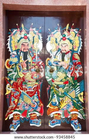 Close up Traditional type of temple gate in China Town Thailand. God of China on the door - stock photo