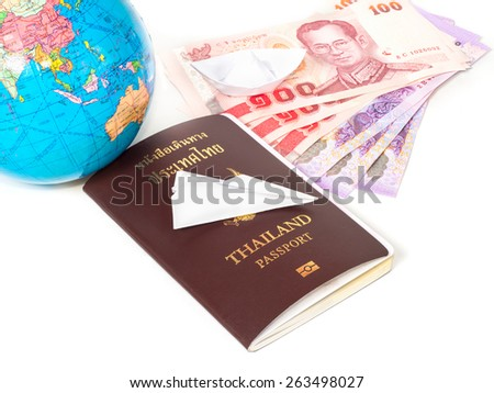 Close up  traveling documents passport,globe and origami paper plane for Travel Concept,Paper boat - stock photo