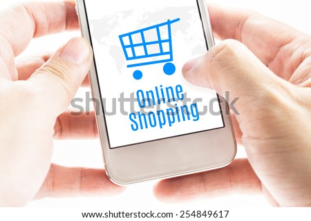 Close up Two hand holding smartphone with Online shopping word and cart icons, Digital Marketing concept - stock photo