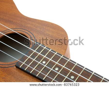 close-up ukulele isolated over white background - stock photo