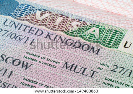 Close up United Kingdom visa in passport - stock photo