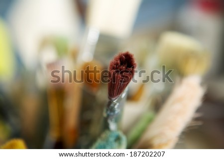 Close up used paintbrushes bristle in focus - stock photo