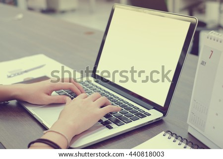 close up user employee woman hand working/typing at notebook in office room:creative people research information knowledge:soft/selective focus:side view perspective photo concept.communication:views - stock photo