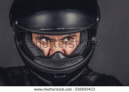 Close up view biker's face in helmet. - stock photo