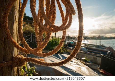 Close up view of a backlit fishing rope before the sunset - stock photo