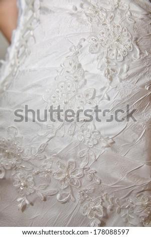 Close-up view of a beautiful wedding dress - stock photo