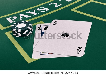 close up view of a blackjack table with cards and fiches (3d render) - stock photo