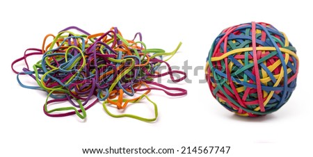 Close up view of a colorful elastic rubber band ball and a unordered pile isolated on a white background. - stock photo