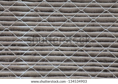 Close up view of a dirty house air filter that needs to be replaced - stock photo