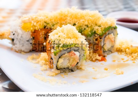 Close up view of a Japanese sushi shrimp tempura roll. - stock photo