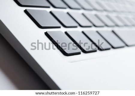 Close up view of a keyboard with dark buttons - stock photo