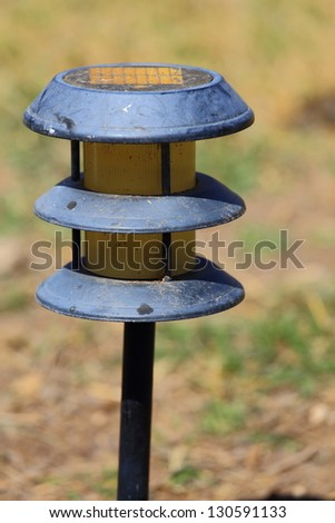 Close up view of a small black plastic solar light - stock photo