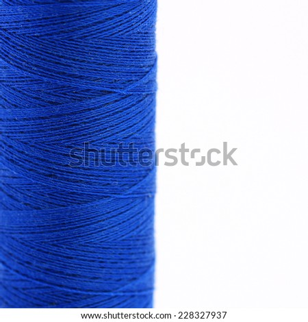 Close-up view of a spool of cobalt blue thread - stock photo