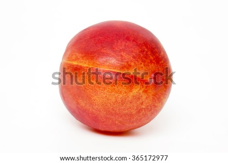 Close up view of a tasty nectarine fruit isolated on white background. - stock photo