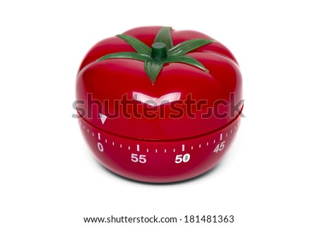 Close up view of a tomato kitchen clock timer isolated on a white background. - stock photo