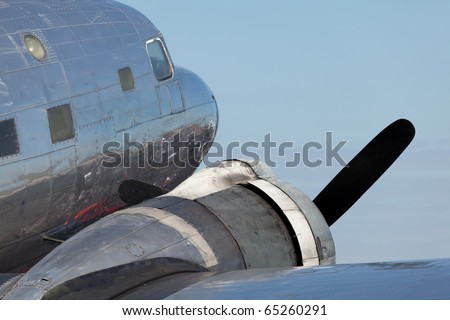 Close up view of a vintage propeller DC-3 airplane. - stock photo