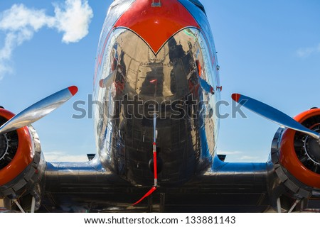 Close up view of a vintage propeller passenger and cargo airplane. - stock photo