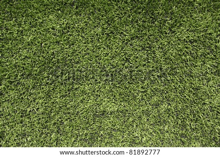 Close up view of artificial turf of a football field for sports background - stock photo