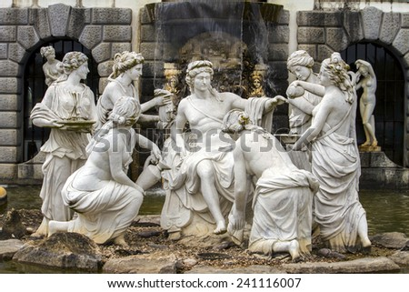 Close up view of artistic and classical statues on a fountain depicting many women and a center man. - stock photo