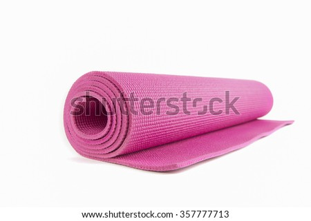 Close up view of blue open yoga mat for exercise, isolated on white background. - stock photo